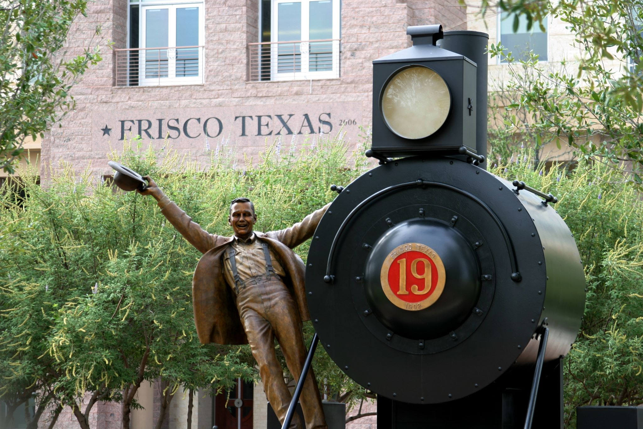 Statue of man on train outside city hall in Frisco Texas