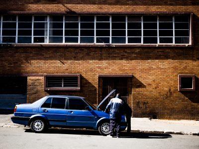 Broken down blue car, car insurance near me in Frisco